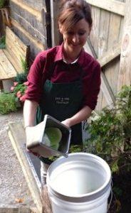 woman using compost bucket