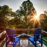 Blue Adirondack chairs on desk with sun